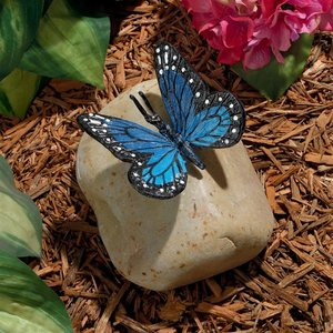 Papilio Ulysses Butterfly on Rock Statue